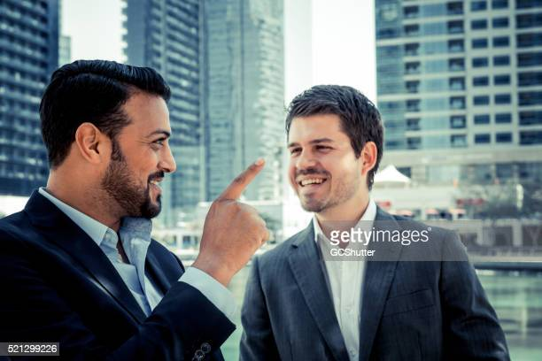 business executives joining hands in agreement - eastern european descent stock pictures, royalty-free photos & images