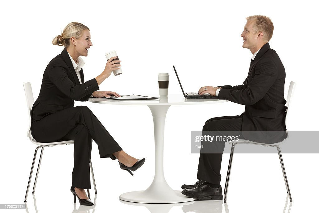 Business Executives Sitting Across From One Another At A Table : Stock Photo