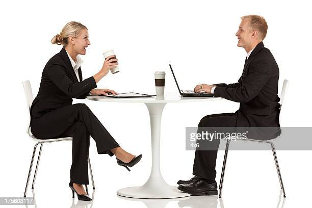Business executives sitting across from one another at a table