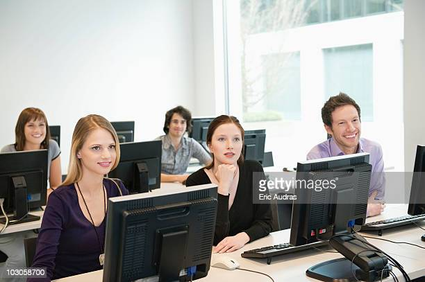 Business executives smiling in a training class