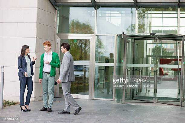 Business executives smoking in front of an office building
