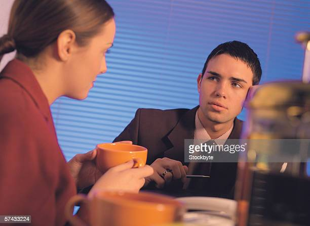 business executives talking over a cup of coffee