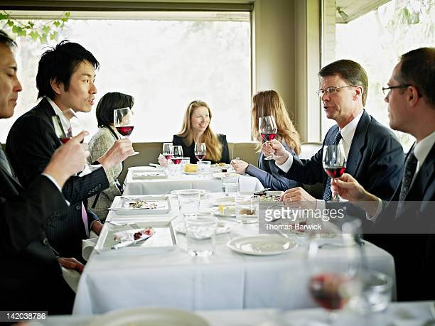 Business executives toasting during lunch meeting