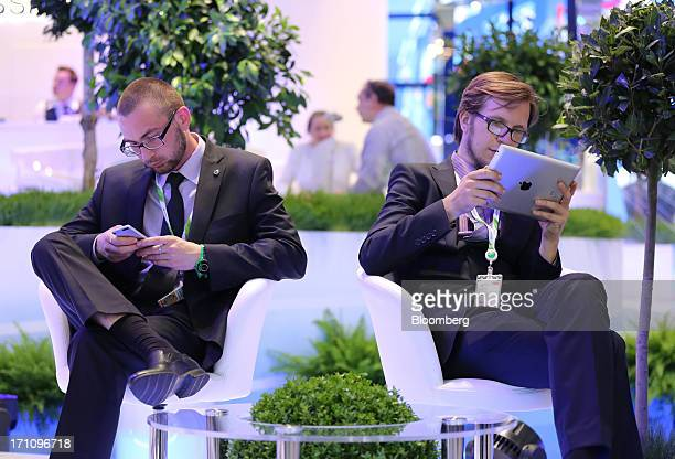 Business executives use mobile devices on the closing day of the St Petersburg International Economic Forum in St Petersburg Russia on Saturday June...