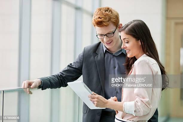 business executives using a digital tablet in an office - onoky stock-fotos und bilder