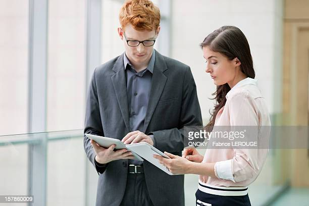 business executives using digital tablets in an office - onoky stock-fotos und bilder
