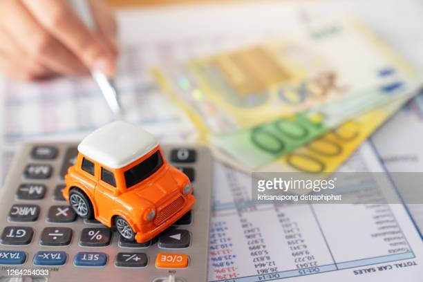business, finance, saving money, banking or car loan concept : top view or flat lay of miniature car model, calculator and pen on office desk table with copy space ready for adding or mock up - tax stock pictures, royalty-free photos & images