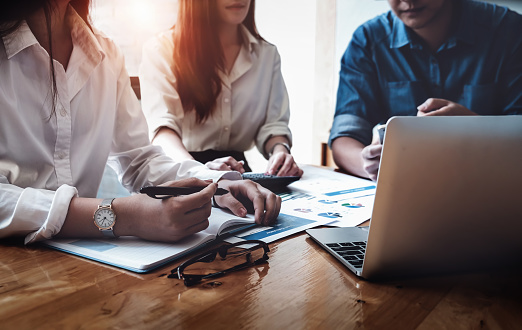 Business financial, Business accountant and discussing with partner are meeting to audit finance planning sales to meet targets set in next year. budget plan concept. 1032388356