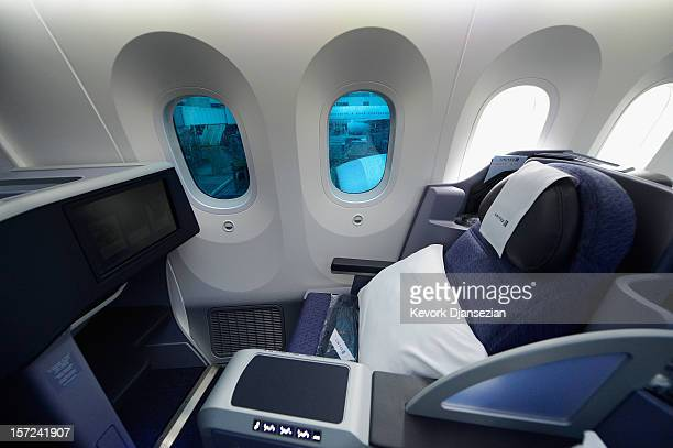 Business First class seating is seen with large dimmable windows with electrochromatic shades that are able to regulate their outside light with the...