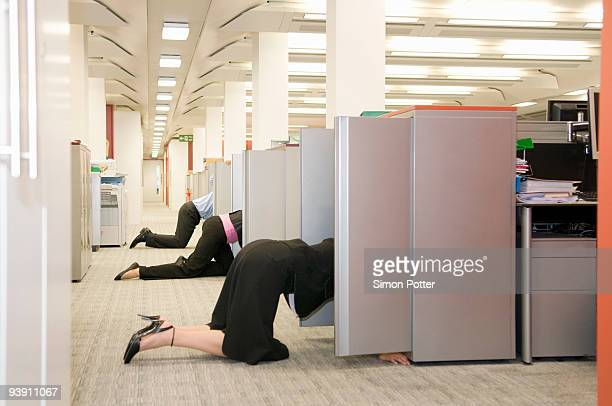 Business folk searching store cupboards