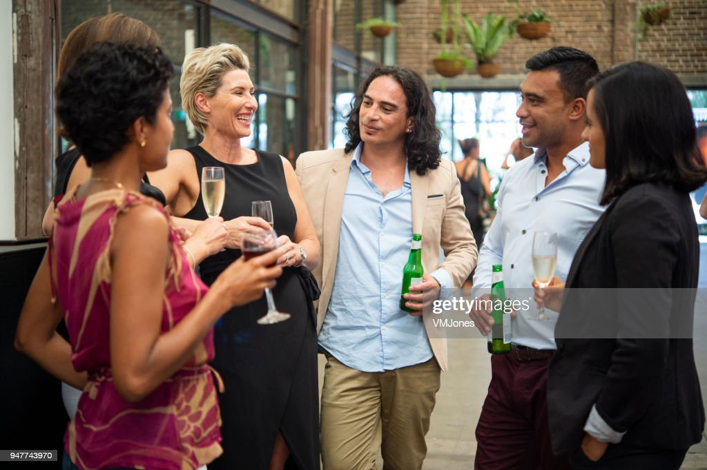 Business Friends Drinking in Bar after work : Stock Photo