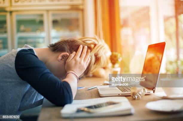 Business girl holding smart-phone and Headaches after working Urgent  job with white background