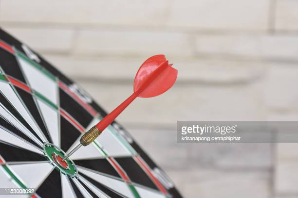 business goals concept,dart arrow hitting in the target center of dartboard - sports target stock photos and pictures