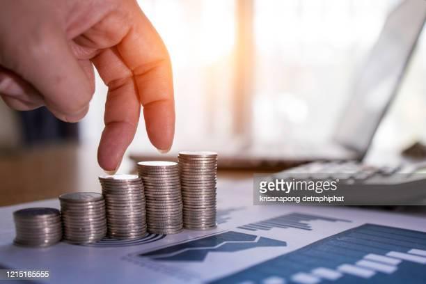 business goals concept,insurance,investment - ganar dinero fotografías e imágenes de stock
