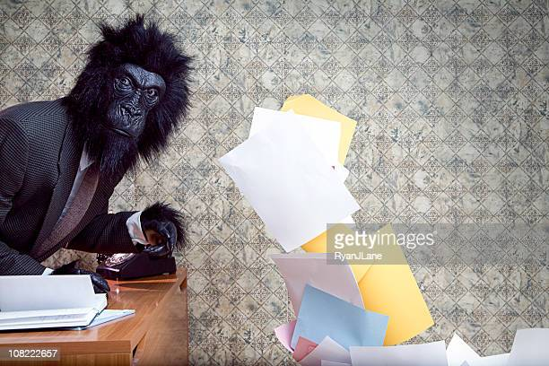 Business Gorilla in the Office Throwing Paper