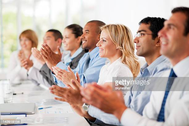Business group clapping.
