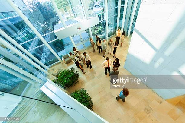 business: group of multi-ethnic, co-workers arrive for work. - headquarters stock pictures, royalty-free photos & images