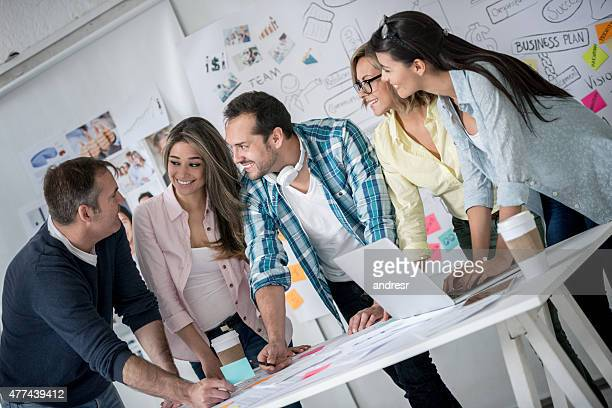 Business group working at a creative office