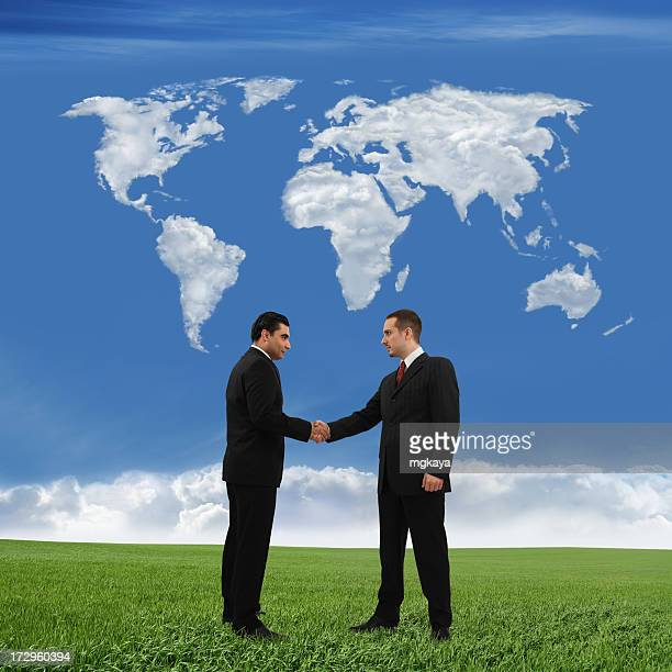 Business Handshake And World Map