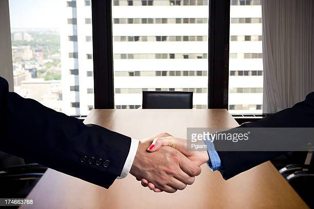 Business handshake deal in an office
