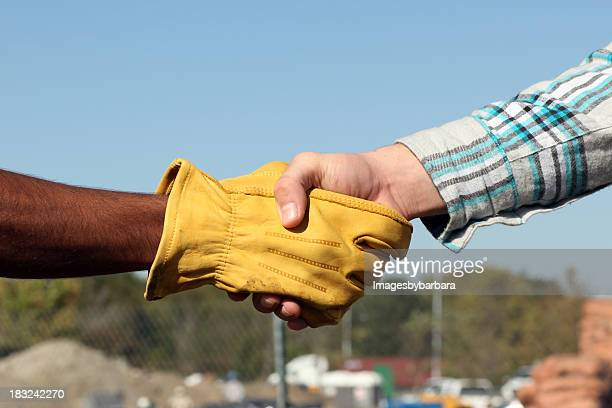 business handshake - work glove stock photos and pictures
