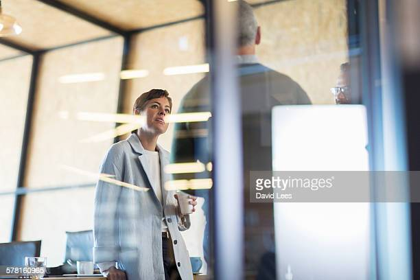 business having meeting in conference room - business finance and industry stock pictures, royalty-free photos & images