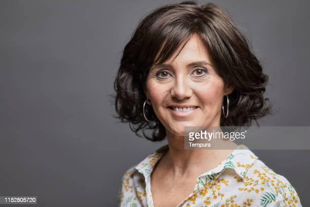 business headshot, portrait looking at camera on gray background. - southern european descent stock pictures, royalty-free photos & images