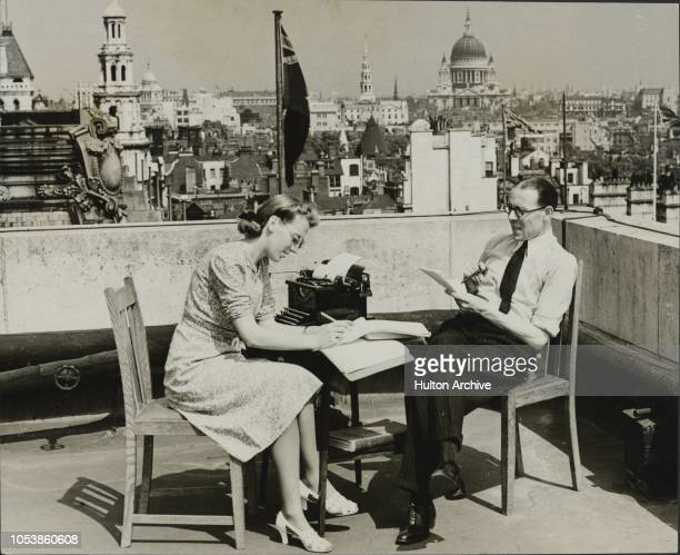 Business in ShirtSleeves The cool breezes playing over the roof of Bush House London enticed this business man and his secretary on to the roof to...