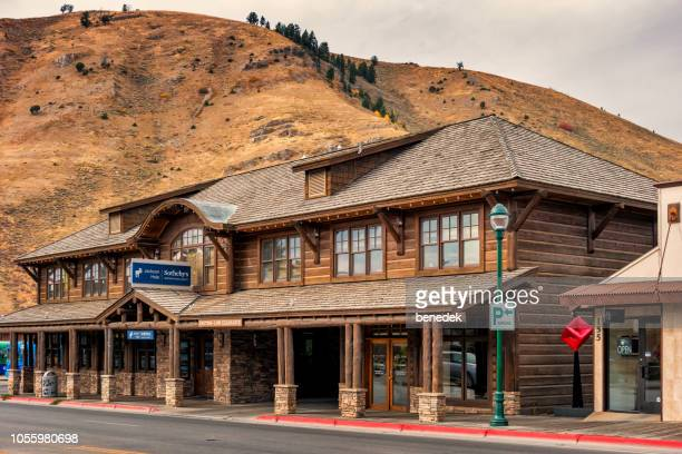 Business in traditional log cabin in downtown Jackson Wyoming USA