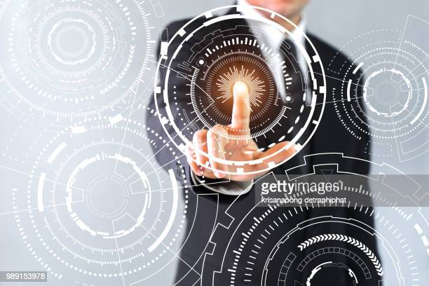 business, internet and technology concept. business select gear icon on virtual screen/ - diagramma di flusso foto e immagini stock
