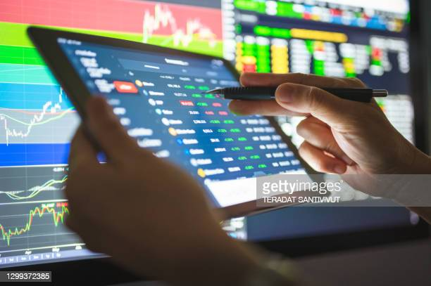 business investor buying stock ,cryptocurrency,bitcoin, through a mobile app and analysis with chart after coronavirus crisis stockmarket going to uptrend market stage - cryptocurrency stock pictures, royalty-free photos & images