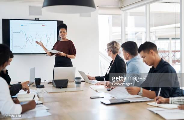 business is op de up and up - medium group of people stockfoto's en -beelden