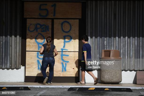 A business is prepared for Hurricane Irma with boarded up windows and doors on September 7 2017 in Key Biscayne Florida Current tracks for Hurricane...
