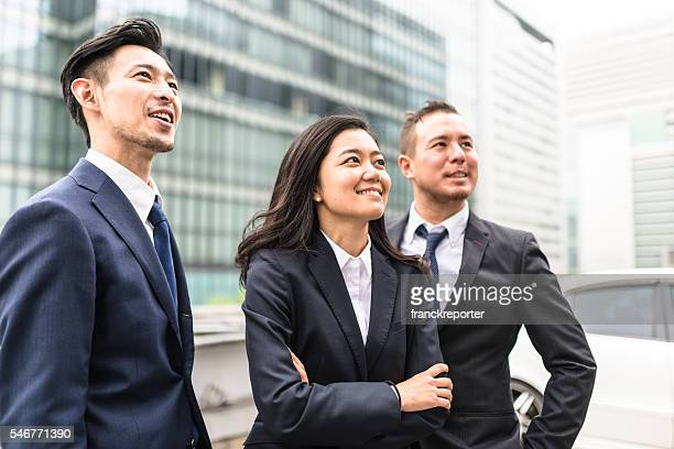 business japanese team standing togetherness - three people ストックフォトと画像
