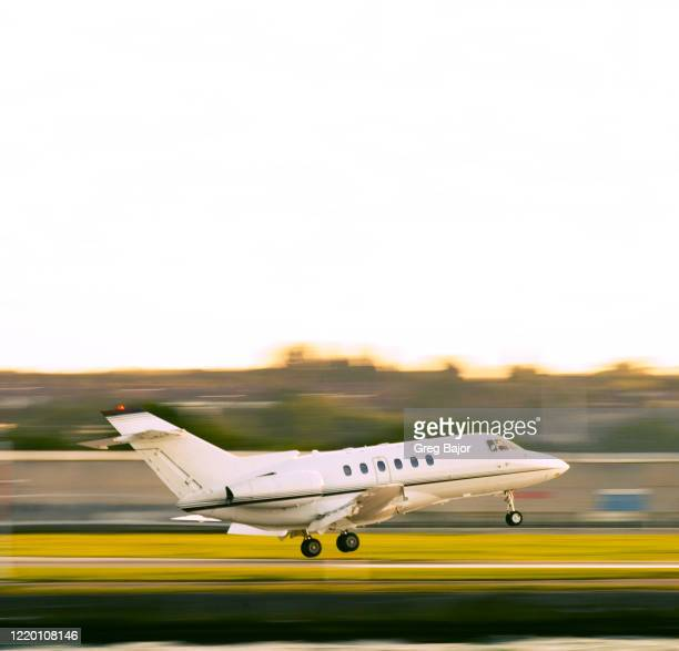 business jet - greg bajor stock pictures, royalty-free photos & images