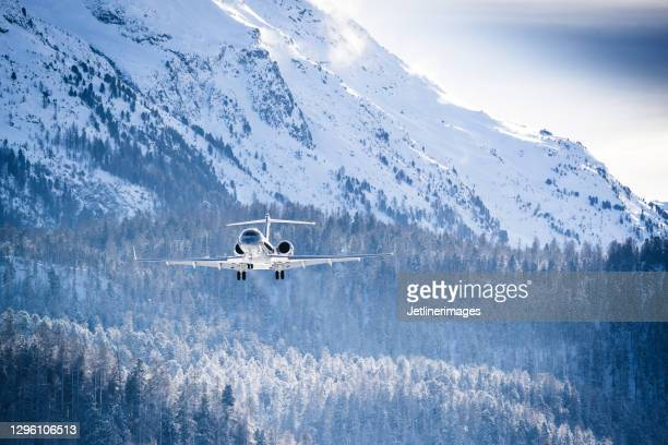 business jet - flying stock pictures, royalty-free photos & images