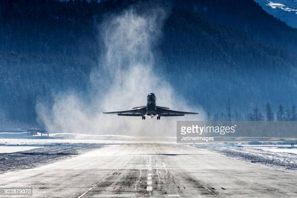 business jet - winter weather stock photos and pictures