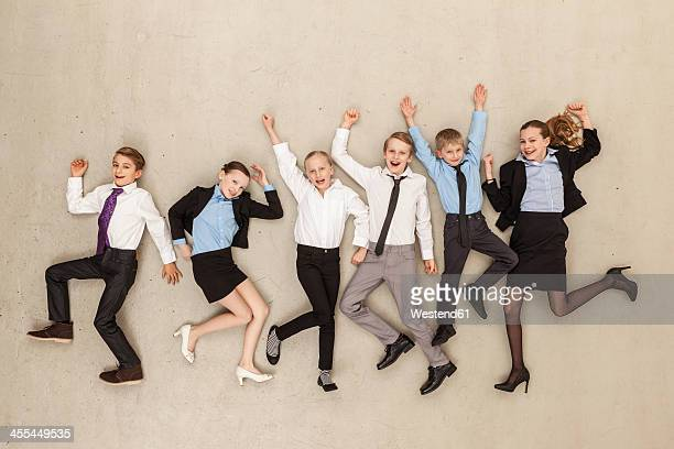 Business kids dancing in office