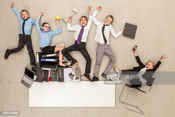 Business kids in office