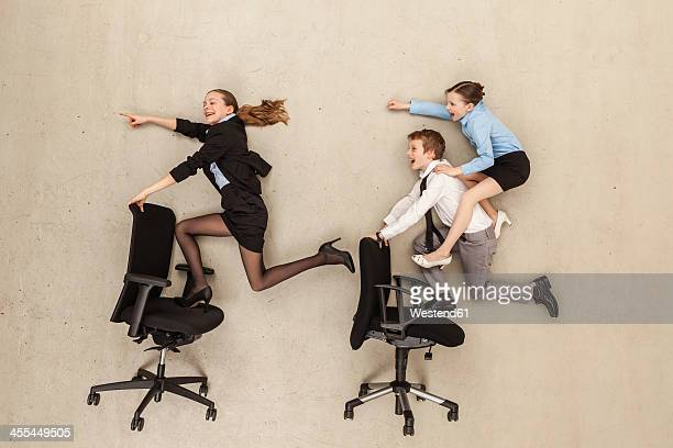 Business kids running in office