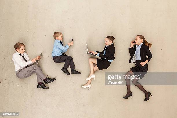Business kids working in office