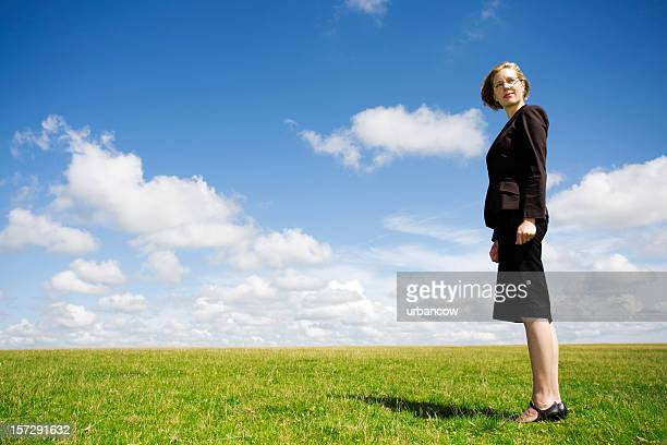 Business lady in a meadow