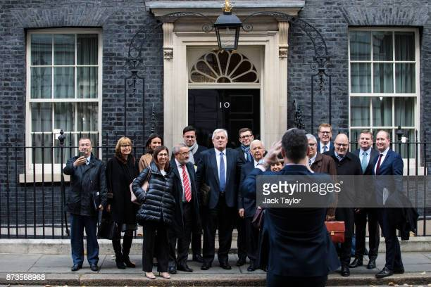 Business leaders and European politicians pose for a photograph as they leave number Number 10 Downing Street on November 13 2017 in London England...