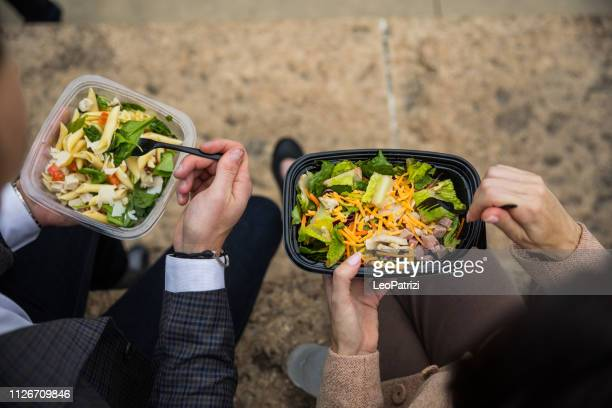 business lunch break in chicago downtown - container stock pictures, royalty-free photos & images