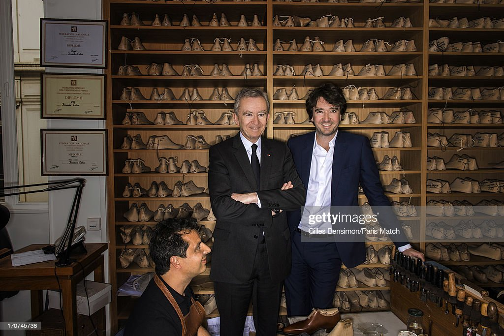 Business magnate and owner of LVMH, Bernard Arnault is photographed with his son Antoine Arnault at Berlutti's bespoke workshop for Paris Match on June 13, 2013 in Paris, France.