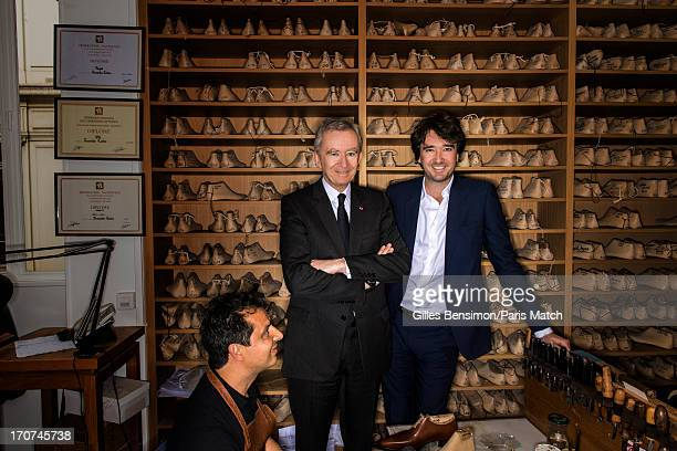 Business magnate and owner of LVMH Bernard Arnault is photographed with his son Antoine Arnault at Berlutti's bespoke workshop for Paris Match on...
