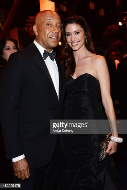 Business magnate Russell Simmons and actress Shannon Elizabeth attend The Weinstein Company Netflix's 2014 Golden Globes After Party presented by...
