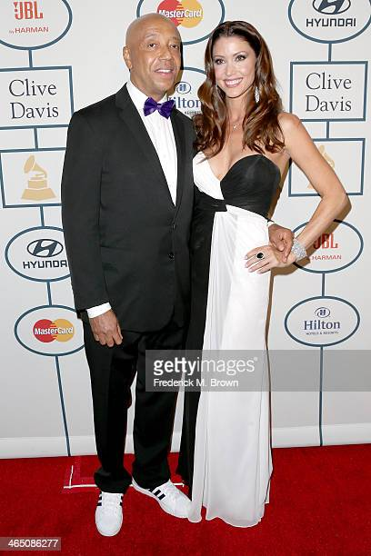 Business magnate Russell Simmons and actress Shannon Elizabeth attend the 56th annual GRAMMY Awards PreGRAMMY Gala and Salute to Industry Icons...