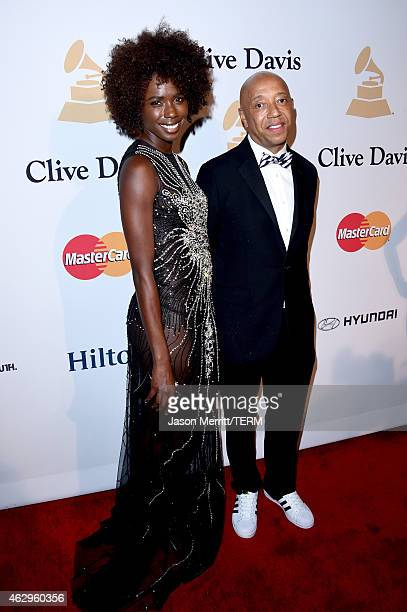 Business magnate Russell Simmons and actress/model Porsche Thomas attend the PreGRAMMY Gala and Salute To Industry Icons honoring Martin Bandier at...