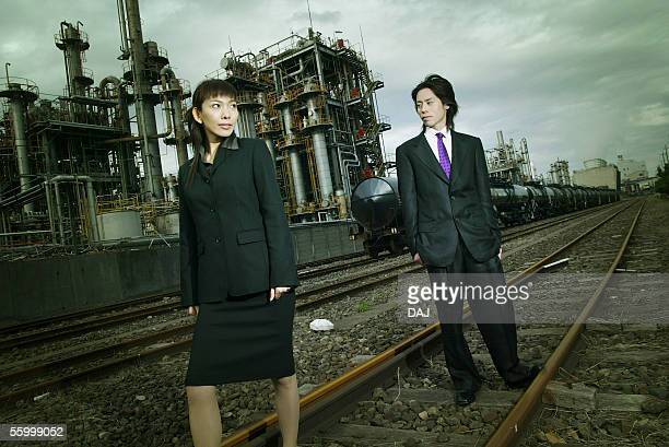 Business Man and Business Woman at the Factory